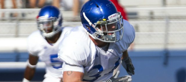 Kansas linebacker Huldon Tharp looks to make a tackle during defensive drills at the Fan Appreciation Day open practice Saturday, Aug. 11, 2012, at Memorial Stadium. 