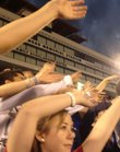Kansas University students &quot;wave the wheat&quot; at KU Traditions Night, Saturday in Memorial Stadium.