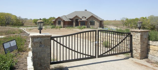 This property located at 1605 E. 550 Road has been seized in connection with a recent bust of a drug ring. The home was under construction by owners Chad Bauman and Carey Willming, who federal agents believe financed the build with drug money.