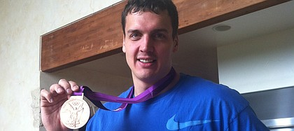 Former Kansas University center Sasha Kaun displays the bronze medal he won with the Russian national team this summer at the 2012 Olympic Games in London. Kaun was the first Jayhawk men's basketball player since Danny Manning to win a medal at the Olympics.