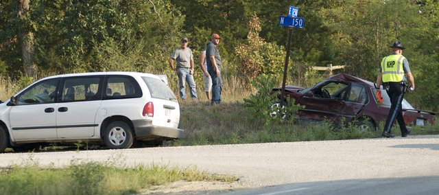 A Kansas Highway Patrol officer works the scene of a fatality accident Tuesday afternoon on U.S. Highway 59 in southern Douglas County. The wreck was at the corner of U.S. 59 and Douglas County North 150 Road, two miles south of Baldwin Junction.