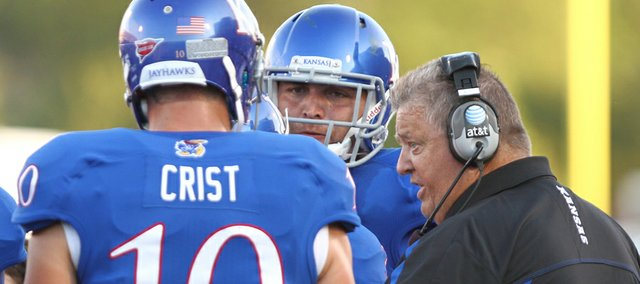 Kansas head coach Charlie Weis has a talk with quarterback Dayne Crist and tight end Mike Ragone in the second quarter, Saturday, September 1, 2012 at Memorial Stadium.