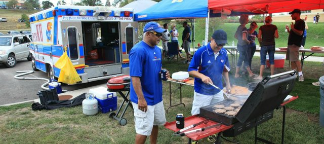 Jayhawk fans grill burgers in front of the Kanbulance outside Memorial Stadium prior to Kansas University&#39;s game against South Dakota State.