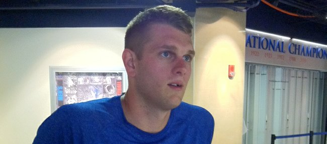 Former Kansas University center Cole Aldrich speaks with reporters during a one-day visit Wednesday, Sept. 5, 2012, to Allen Fieldhouse.