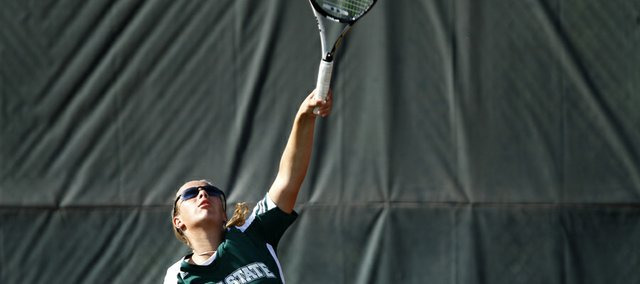 Free State singles player Alexis Czapinski serves during a match against Olathe South player Navya Prabhushankar on Tuesday, Sept. 4, 2012 at Lawrence High School.
