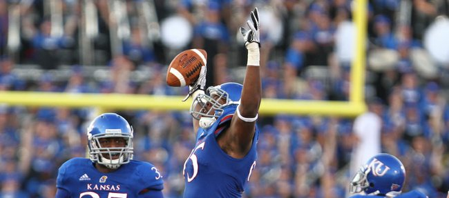Kansas defensive lineman Josh Williams raises his arms after recovering a fumble by South Dakota State in the second quarter, Saturday, September 1, 2012 at Memorial Stadium.