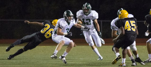 Free State's Joe Dineen (12) avoids Shawnee Mission West's Tory Powell (36) as he finds some running room on a kick return during Free State's game against Shawnee Mission West Friday, Sept. 07, 2012, in Overland Park.