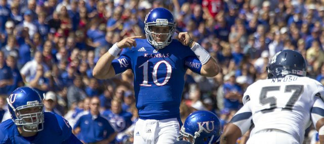 Kansas' Dayne Crist (10) makes adjustments at the line of scrimmage during Kansas' game against Rice Saturday, Sept. 8, 2012, at Memorial Stadium.