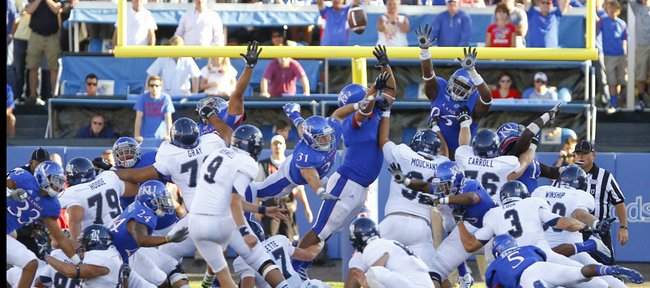 A field goal from Rice kicker Chris Boswell sails over a pack of lunging Jayhawks to win the game for the Owls 25-24 on Saturday, Sept. 8, 2012 at Memorial Stadium.
