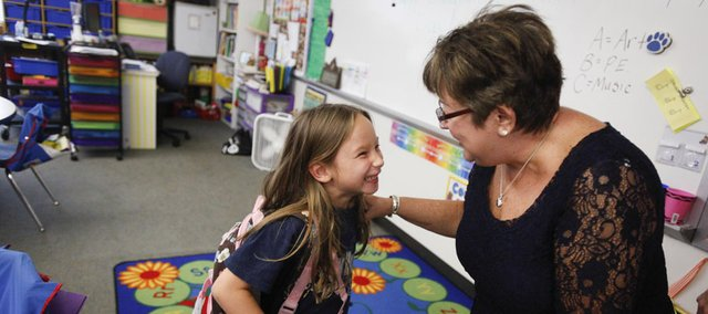 First-grader Maura Langland flashes a big smile to her grandmother, Jenay Weekly, of Topeka, as the two prepare to leave school together after a Grandparents Day celebration on Friday at Langston Hughes School, 1101 George Williams Way. Grandparents and special guests from near and far were treated to tours of the school from their special students along with activities, performances and snacks.