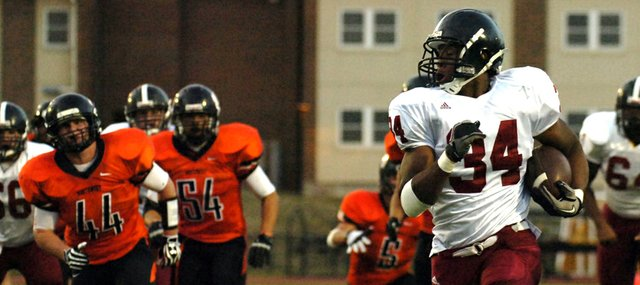 Lawrence High's Tyrone Jenkins (34) takes off for the end zone in the first quarter against Shawnee Mission Northwest, Friday, Sept. 7, 2012, in Overland Park.