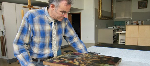"Scott Heffley, senior conservator of paintings at Kansas City's Nelson-Atkins Museum of Art, examines the Spencer Museum of Art's painting by Giorgio Vasari. Heffley conserved the work as part of the preparation for the Spencer's exhibit, ""Giorgio Vasari and Court Culture in Late Renaissance Italy."""
