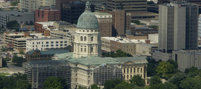The Kansas Statehouse is seen in downtown Topeka, Kan. Tuesday, June 23, 2009.