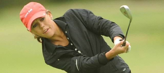 Lawrence High senior Quillen Eichhorn chips onto the the green, Thursday, Sept. 13, 2012, at Alvamar golf course.