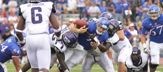 Kansas quarterback Dayne Crist fumbles as he is hit by several TCU defenders on the Jayhawks' last drive of the fourth quarter, Saturday, Sept. 15, 2012 at Memorial Stadium.