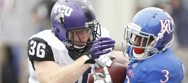 Kansas receiver Tony Pierson is sent out of bounds by TCU linebacker Joel Hasley after a catch during the second quarter, Saturday, Sept. 15, 2012 at Memorial Stadium.