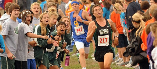 Free State's Trail Spears gets support from fellow FSHS students during the Baldwin Invitational Cross Country meet  on Saturday, Sept. 15, 2012.