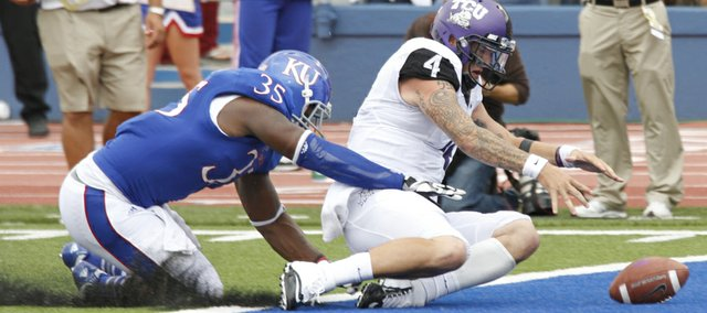 Kansas defensive end Toben Opurum (35) forces TCU quarterback Casey Pachall (4) to fumble in the end zone during the forth quarter of their game Saturday, Sept. 15, 2012 at Memorial Stadium.