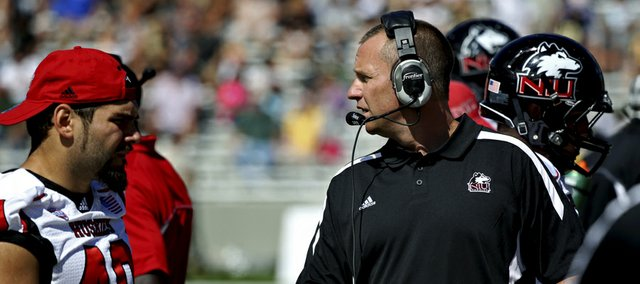 Northern Illinois coach Dave Doeren walks the sideline in the first half of NIU's game against Army on Saturday in West Point, N.Y. After facing Army's run-heavy offense, the Huskies are preparing to face a more balanced attack from Kansas University on Saturday.