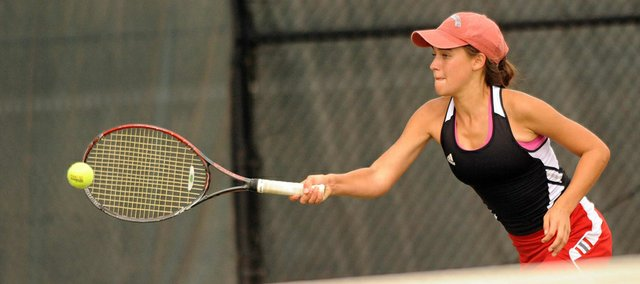 Brooke Braman returns a shot against a Shawnee Mission West on Monday, Sept. 17, 2012, at the LHS courts.