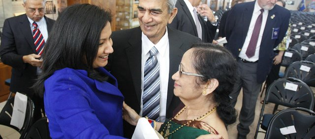 Neeli Bendapudi, dean of the Kansas University School of Business, left, shares a moment with her parents, Ramesh and Padma Thippavajjala, following a naturalization ceremony Monday in which they were granted American citizenship. Ninety-seven individuals took the oath of citizenship during the ceremony at the Dole Institute of Politics.