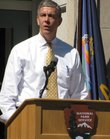 U.S. Education Secretary Arne Duncan speaks Tuesday at the Brown v. Board National Historic Site.
