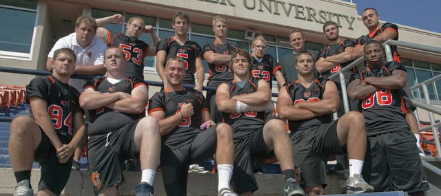 Baker University football team members from Lawrence schools, front row, from left, Dominick Reiske (LHS), Justin McCandless (FSHS), Ryder Wertz (FSHS), Ben Seybert (LHS), Cale Nieder (FSHS) and Aundre Allen (FSHS); and back row from left, trainer Colter Scott (FSHS), Matt Cole (FSHS), Dylan Perry (FSHS), Conner Stremel (FSHS), Jack Caywood (FSHS), coach Jason Thoren (LHS), Jake Green (LHS), and Preston Schenck (FSHS).