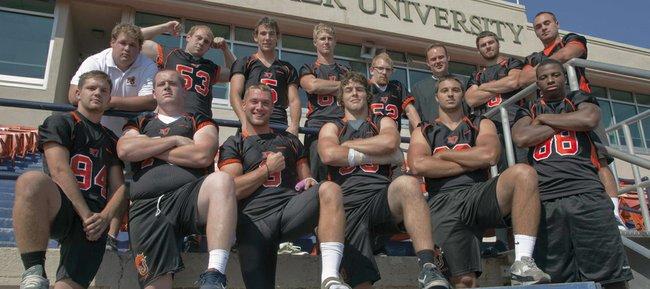 Baker University football team members from Lawrence schools, front row, from left, Dominick Reiske (LHS), Justin McCandless (FSHS), Ryder Wertz (FSHS), Ben Seybert (LHS), Cale Nieder (FSHS) and Aundre Allen (FSHS); and back row from left, trainer Colter Scott (FSHS), Matt Cole (FSHS), Dylan Perry (FSHS), Conner Stremel (FSHS), Jack Caywood (FSHS), coach Jason Thoren (LHS), Jake Green (LHS), and Preston Schenck (FSHS).