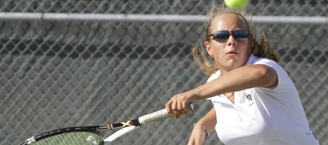 Free State's Alexis Czapinski competes against an Olathe Northwest opponent during a quad tennis meet Wednesday, Sept. 19, 2012, at FSHS.