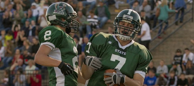 Free State's Blake Winslow (7) and Chris Heller (2) celebrate Winslow's touchdown during Free State's game against Olathe North on Friday, Sept. 21, 2012, at FSHS.