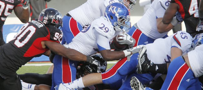 James Sims (29) pushes into the end zone for a touchdown in the second half of KU's 30-23 loss to the Northern Illinois Huskies on Saturday, Sept. 22, 2012, at Huskie Stadium in DeKalb, Ill.