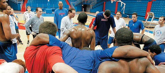 KU coach Bill Self huddles with the Jayhawks after a Boot Camp conditioning session in this file photo from 2006. 