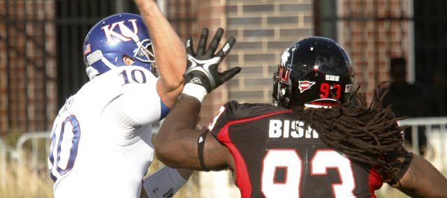 KU quarterback Dayne Crist (10) is pressured by the Huskies Ken Bishop (93) in the second half of KU&#39;s 30-23 loss to Northern Illinois Huskies Saturday, September 22, 2012, at Huskie Stadium in DeKalb, Ill.