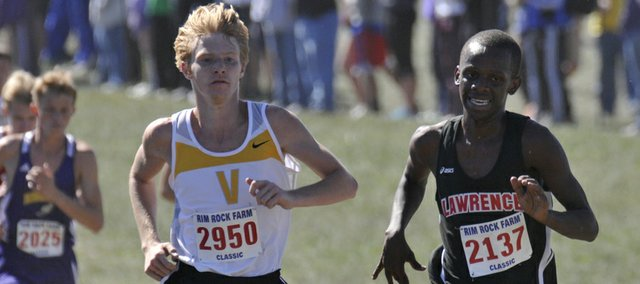 Lawrence High's John Mwithiga races on Saturday, Sept. 22, 2012, at the Rim Rock Farm Classic.