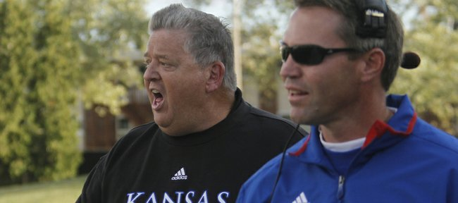 KU coach Charlie Weis, left, argues about a holding call on an extra-point attempt with defensive back coach Clint Bowen, right, in the second half of KU's 30-23 loss to Northern Illinois Huskies Saturday, September 22, 2012, at Huskie Stadium in DeKalb, Ill.