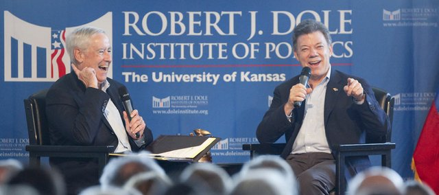 Colombian president Juan Manuel Santos, right, laughs alongside Bill Lacy, director of the Dole Institute of Politics, as Santos recounts a story Monday from his days as an undergraduate at Kansas University. Santos, a 1973 graduate of KU, was in Lawrence to receive the Alumni Distinguished Achievement Award.