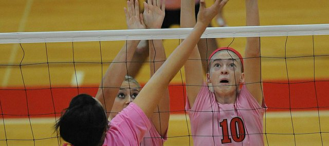 Lawrence High's Monica Howard (10) tries to get her hands on a return against Dodge City in the first round of  Joan L. Wells Invitational on Saturday, Sept. 29, 2012, at LHS.