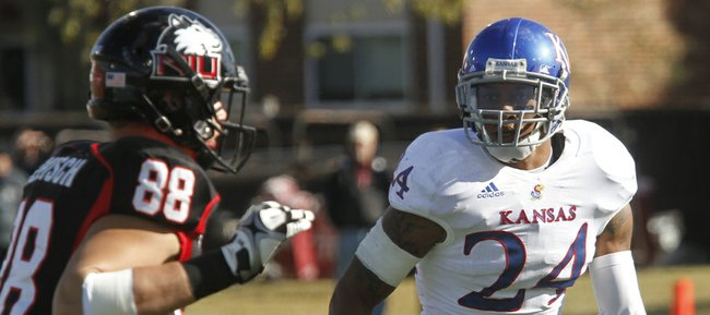 Kansas University safety Bradley McDougald (24) matches up with Northern Illinois tight end Tim Semisch in the first half of KU's game against the Huskies, Saturday, Sept. 22, 2012, in DeKalb, Ill.