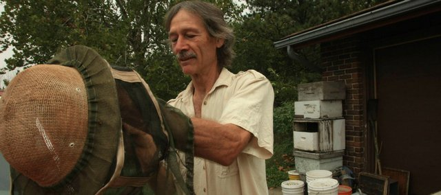 Richard Bean, who lives near Baldwin and owns Blossom Trail Bee Ranch, gets ready to check his hives on Thursday Sept 27, 2012. Bean's farm is one of 22 included in this weekend's Kaw Valley Farm Tour.