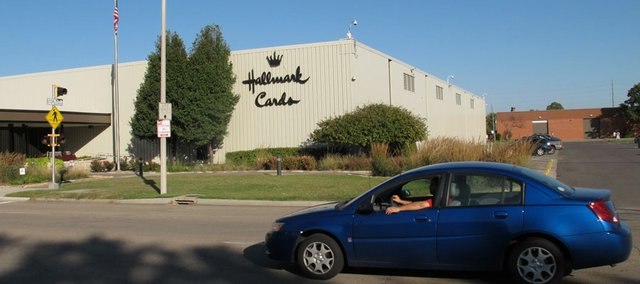A car moves past the Hallmark Cards Inc. plant in Topeka, Kan., Tuesday, Oct. 2, 2012. The company says it plans to close the plant by the end of 2013.