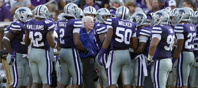 In this Sept. 1, 2012, file photo, Kansas State coach Bill Snyder, center, talks to his team during a timeout in a game against Missouri State in Manhattan.