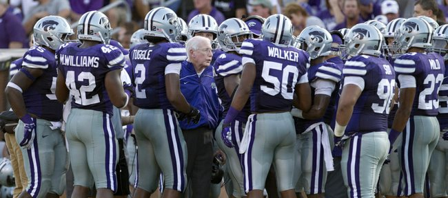 In this Sept. 1, 2012, file photo, Kansas State coach Bill Snyder, center, talks to his team during a timeout in a game