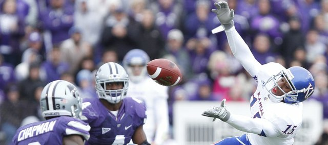 Kansas receiver Daymond Patterson loses hold of a catch before Kansas State defensive back Allen Chapman during the second quarter on Saturday, Oct. 6, 2012 at Bill Snyder Family Stadium in Manhattan.