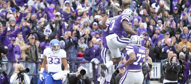 Kansas cornerback Tyler Patmon walks away as Kansas State players celebrate a touchdown by receiver Tyler Lockett during the second quarter on Saturday, Oct. 6, 2012 at Bill Snyder Family Stadium in Manhattan.