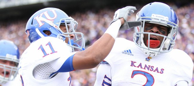 Kansas receiver Tre' Parmalee (11) celebrates after running back Tony Pierson's (3) touchdown against Kansas State during the first quarter on Saturday, Oct. 6, 2012 at Bill Snyder Family Stadium in Manhattan.