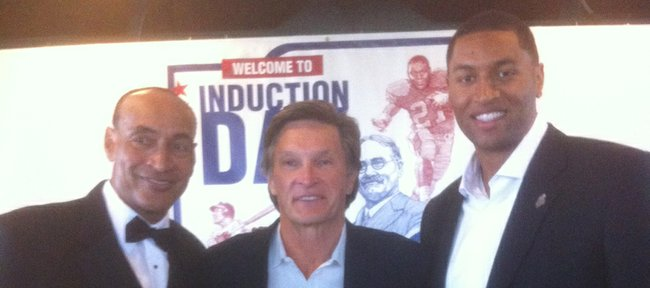 Former Jayhawks, from left, Bud Stallworth, David Jaynes and Wayne Simien pose at induction ceremonies for the Kansas Sports Hall of Fame on Sunday in Wichita.