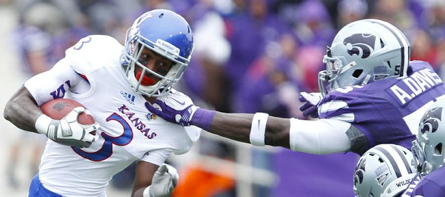 Kansas running back Tony Pierson is yanked down by the collar by Kansas State defensive end Adam Davis during the first quarter on Saturday, Oct. 6, 2012 at Bill Snyder Family Stadium in Manhattan.