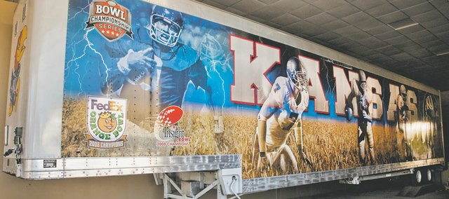 This trailer — not owned by KU — hauls football equipment to games and used to have a Maine license plate.