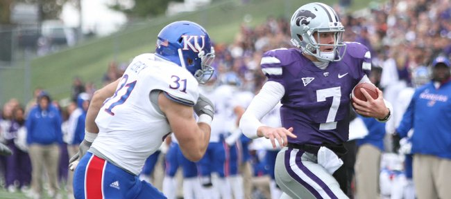 Kansas State quarterback Collin Klein escapes linebacker Ben Heeney for a carry during the third quarter on Saturday, Oct. 6, 2012 at Bill Snyder Family Stadium in Manhattan. 