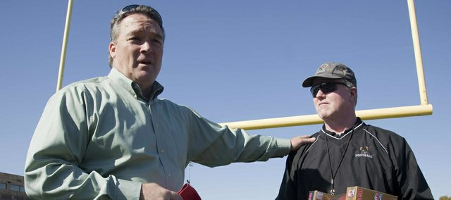 Gary Spani, of the Kansas City Chiefs, was on hand Wednesday Oct. 10, 2012, at FSHS to award coach Bob Lisher, right, with Kansas City Chiefs' Kansas High School Coach of the Week Award.